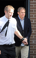 Pictured: Matthew Hargreaves (R) is taken away in a prison van after the hearing at Merthyr Tydfil Crown Court. Friday 16 September 2016<br /> Re: Rogue traders Matthew Hargreaves and John Barry Hargreaves have been jailed for 18 months and Jean Hargreaves has been given  suspended sentence by Merthyr Tydfil Crown Court for selling a teeth whitening product with harmful levels of hydrogen peroxide, 110 times the legal limit, after a three year nationwide investigation by Powys County Council's Trading Standards Service culminated in guilty pleas being entered by three Manchester based rogue traders. <br /> Charges relating to Fraud and Consumer Protection offences were pursued relating to the sale of unsafe teeth whitening products across the UK.