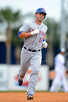 New York Mets infielder Brandon Hicks #12 runs the bases after hitting a home run during a Spring Training game against the Detroit Tigers at Joker Marchant Stadium on March 11, 2013 in Lakeland, Florida.  New York defeated Detroit 11-0.  (Mike Janes/Four Seam Images)