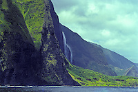 A spectacular waterfall cascades down the secluded lush mountains near Wailau Valley on Molokai's north shore.