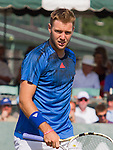 Jack Sock (USA) loses to Ivo Karlovic (CRO) 7-6, 6-4 at the Tennis Hall of Fame Championships in Newport, Rhode Island on July 18, 2015.