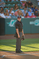 Umpire Nic Schmittou handles the calls behind the plate during the game between the Ogden Raptors and the Rocky Mountain Vibes at Lindquist Field on July 5, 2019 in Ogden, Utah. The Raptors defeated the Vibes 6-4. (Stephen Smith/Four Seam Images)