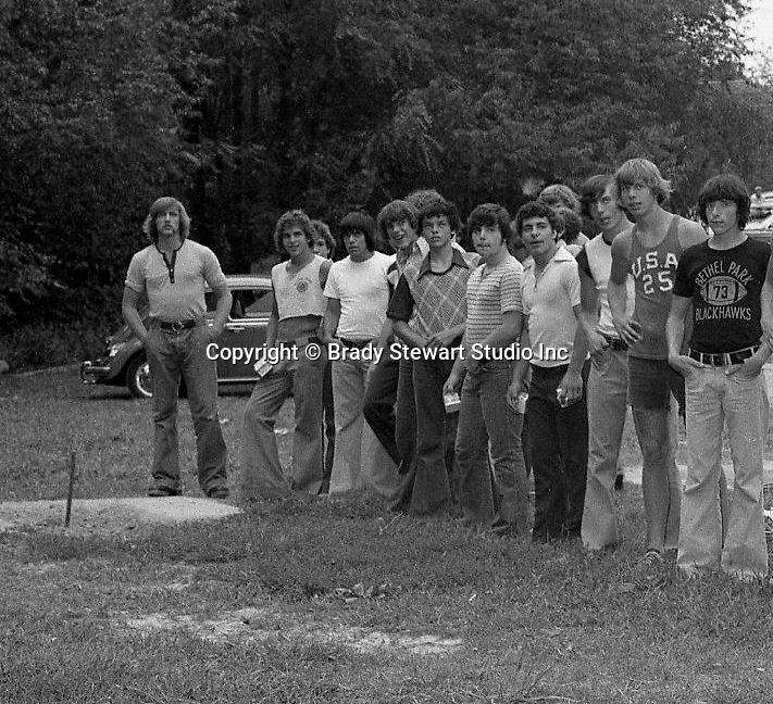 Bethel Park PA: View of members of the Bethel Park High School football team playing horseshoes during the annual Bethel Park Athletic Association (BPAA) picnic at Lyons Park.<br /> The picnic gave the Bethel Park boosters a chance to meet the football team and coaches.