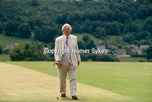 Laurie Lee author. Slad his home village, walking on cricket pitch, near Stroud Gloucestershire 1994, 1990s,