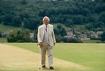 Laurie Lee author. Slad his home village, walkng on cricket pitch, near Stroud Gloucestershire