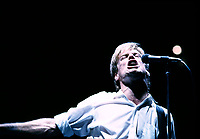 January 1985 file photo-<br /> Canadian singer / guitarist Bryan Adams in concert at the Montreal Forum in 1985<br />  <br /> <br /> With his distinctive vocals and blue-collar songwriting skills, Canadian icon Bryan Adams' take on rock 'n' roll basics found a niche that has lasted for over 20 years.<br /> <br /> Adams solo career was launched with the release of his self-titled debut album Bryan Adams in February of 1980 on A&M Records. Adams had already been touring, recording demos and working as a studio musician paying his rent for a few years, but it was when Adams formed a song-writing partnership with drummer Jim Vallance that things started to happen.<br /> <br /> <br /> NOTE 35mm slide scanned with Kodak RFS 3600,saved in Adobe 1998 RGB.