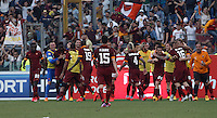 Calcio, Serie A: Lazio vs Roma. Roma, stadio Olimpico, 25 maggio 2015.<br /> Roma's Mapou Yanga-Mbiwa, third from left, celebrates after scoring the winning goal during the Italian Serie A football match between Lazio and Roma at Rome's Olympic stadium, 25 May 2015. Roma won 2-1.<br /> UPDATE IMAGES PRESS/Isabella Bonotto