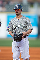 Birmingham Barons first base coach Michael Johnson (5) during the game against the Tennessee Smokies at Regions Field on May 3, 2015 in Birmingham, Alabama.  The Smokies defeated the Barons 3-0.  (Brian Westerholt/Four Seam Images)