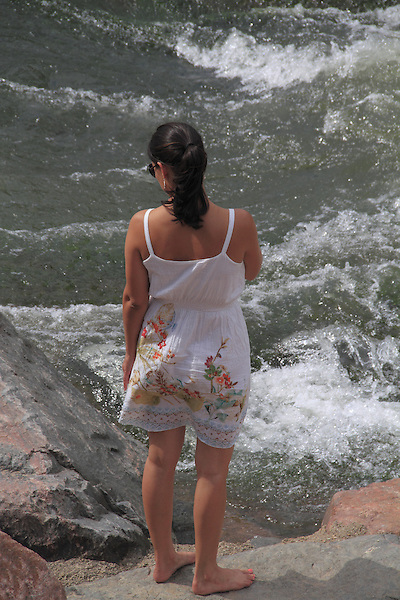 Woman standing along river in Denver, Colorado. .  John offers private photo tours in Denver, Boulder and throughout Colorado. Year-round Colorado photo tours.