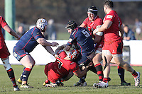 Wilhelm van der Sluys of London Scottish (5) is tackled by Gary Graham  of Jersey Reds (7) during the Greene King IPA Championship match between London Scottish Football Club and Jersey at Richmond Athletic Ground, Richmond, United Kingdom on 18 February 2017. Photo by David Horn / PRiME Media Images.