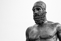"Reggio Calabria (Italy), 05/08/2018. Visiting the Museo Nazionale della Magna Grecia, in Reggio Calabria, to photograph the ""Bronzi di Riace"" (The Riace Bronzes). Today could be the last ""Domenica [gratis] al Museo"" (""Free Sundays at the Museum""). The initiative of ""Free Sundays"" is a state run project, involving 480 museum and cultural sites across Italy. It was launched by Ministerial Decree no.94/2014, by the Ministry of Cultural Heritage and Activities the MiBAC). Recently, the new Culture Minister of Italy, Alberto Bonisol of the Five Star Movement (Member of the Italian Coalition Government Five Star Movement / League), labelled the ""Free Sundays"" project a ""publicity campaign"" and stated he is going to abolish the project in September this year.<br />