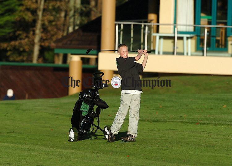 Shane Duggan plays his second shot to the 4th green at Ennis Golf Club.Pic Arthur Ellis.