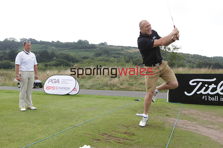 ISPS Handa Wales Open 2013<br /> Celtic Manor Resort<br /> Mike Tindall having a go at one leg golf during a teaching clinch organised by tournament sponsor ISPS Handa.<br /> <br /> 28.08.13<br /> <br /> ©Steve Pope-Sportingwales