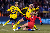 COLUMBUS, OH - NOVEMBER 07: Emma Kullberg #23 of Sweden tries to defend the shot of Lindsey Horan #9 of the United States along with Magdalena Eriksson #6 during a game between Sweden and USWNT at Mapfre Stadium on November 07, 2019 in Columbus, Ohio.