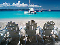 Adirondack chair boats and beach. Jost Van Dyke. British Virgin Islands