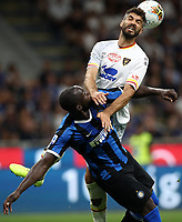 Calcio, Serie A: Inter Milano - Lecce, Giuseppe Meazza stadium, September 26 agosto 2019.<br /> Lecce's Luca Rossettini (r) in action with iInter's Romelu Lukaku (l) reacts during the Italian Serie A football match between Inter and Lecce at Giuseppe Meazza (San Siro) stadium, September August 26,, 2019.<br /> UPDATE IMAGES PRESS/Isabella Bonotto