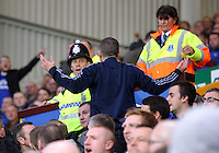 Liverpool, UK. Saturday 01 November 2014<br /> Pictured: Police and stadium security stewards remove an Everton supporter.<br /> Re: Premier League Everton v Swansea City FC at Goodison Park, Liverpool, Merseyside, UK.
