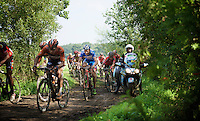 As this was the first edition of a 'revamped' Schaal Sels, the organisers and race officials (nor the riders/teams for that matter...) didn't know exactly what to expect of the 'gravel' roads that were introduced for a very first time ever in a 'road race' in Belgium. Moto's were not equipped to cope with the mud and weren't able to get out of the way in time for the riders to pass. Even when that motor-pilot in none other than ex cyclocross world champion Paul Herygers (BEL), who works as an official for the Belgian Cycling Federation. <br /> <br /> <br /> 90th Schaal Sels 2015
