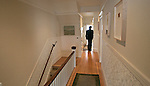 A potential house buyer looks at a flat in Cole Valley San Francisco, California