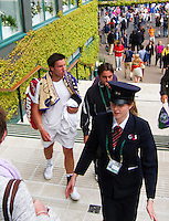 25-06-13, England, London,  AELTC, Wimbledon, Tennis, Wimbledon 2013, Day two, Igor Sijsling (NED) end his coach Joaquin Munoz Berajano being escorted to the players lounge after his first round win<br /> <br /> <br /> <br /> Photo: Henk Koster