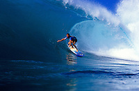 Derick Doerner surfing a large wave, X-Cel water patrol, Hawaii