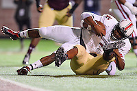 Texas State defensive end Michael Odiari (55) sack Louisiana Lafayette quarterback Terrance Broadway (8) during first half of an NCAA football game, Tuesday, October 14, 2014 in San Marcos, Tex. Louisana Lafayette leads 21-3 at the halftime. (Mo Khursheed/TFV Media via AP Images)