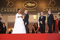Rihanna et Jeffrey Katzenberg sous le regard de Thierry Fremeaux et Pierre Lescure sur le tapis rouge pour la projection du film en competition OKJA lors du soixante-dixiËme (70Ëme) Festival du Film ‡ Cannes, Palais des Festivals et des Congres, Cannes, Sud de la France, vendredi 19 mai 2017.