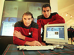 Lorenzo Amoruso and Giovanni Van Bronckhorst launch the Rangers website. Space age stuff or what?