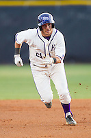 Josh Spano (21) of the High Point Panthers takes off for third base against the Coastal Carolina Chanticleers at Willard Stadium on March 15, 2014 in High Point, North Carolina.  The Panthers defeated the Chanticleers 11-8 in game two of a double-header.  (Brian Westerholt/Four Seam Images)
