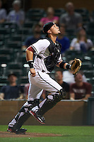 Salt River Rafters catcher Oscar Hernandez (25) tracks a foul ball popup during an Arizona Fall League game against the Scottsdale Scorpions on October 13, 2015 at Salt River Fields at Talking Stick in Scottsdale, Arizona.  Salt River defeated Scottsdale 5-3.  (Mike Janes/Four Seam Images)