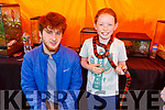 Emily O'Connor with a snake around her neck pictured with Toby Lennon at the Annual Heritage Day at the Old Forge Churchill on Saturday.