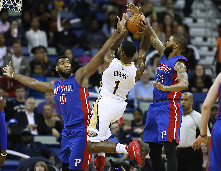 New Orleans Pelicans guard Tyreke Evans (1) drives against Detroit Pistons center Andre Drummond (0) and forward Marcus Morris (13) during the second half of an NBA basketball game Thursday, Jan. 21, 2016, in New Orleans. The Pelicans won 115-99. (AP Photo/Jonathan Bachman)
