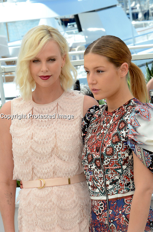 Charlize Theron Adele Exarchopoulos attends ' the last face' Photocall durig The 69th Annual Cannes Film Festival on May 20, 2016 in Cannes
