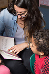 Education Preschool 3-4 year olds childcare boy listening and talking with speech therapist in classroom