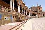 Plaza de Espana designed by Anibal Gonzalez was built in 1928 for the Ibero- American Exposition of 1929 is located in the Maria Luisa Park in Seville, Spain. By the walls of the Plaza are many tiled alcoves, each representing a different province of Spain..