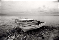 Rowboats pulled onto shore<br />