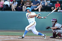 Brian Carroll #24 of the UCLA Bruins bats against the Stanford Cardinal at Jackie Robinson Stadium on May 2, 2014 in Los Angeles, California. UCLA defeated Stanford, 7-2. (Larry Goren/Four Seam Images)