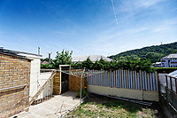 Pictured: The car wash as seen from the back garden of the house owned by Anne Parker in Pontypridd, Wales, UK. Monday 02 July 2018<br /> Re: Pensioner Anne Parker says the peace and quiet of her garden has been shattered after a car wash was installed by rental firm Enterprise on the other side of her back fence in Pontypridd, Wales, UK.