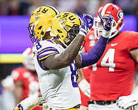 ATLANTA, GA - DECEMBER 7: Patrick Queen #8 of the LSU Tigers celebrates a defensive stop during a game between Georgia Bulldogs and LSU Tigers at Mercedes Benz Stadium on December 7, 2019 in Atlanta, Georgia.