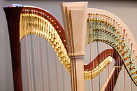 Harps sit on stage before the start of the Composition Forum at the 11th USA International Harp Competition at Indiana University in Bloomington, Indiana on Monday, July 8, 2019. (Photo by James Brosher)