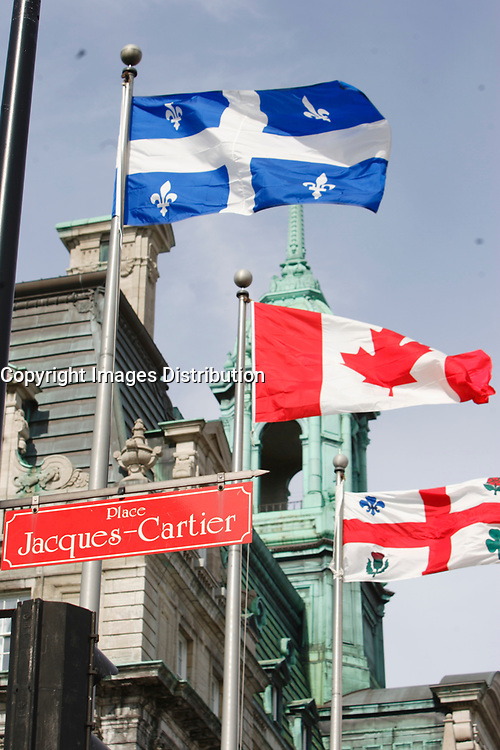 Montreal (Qc) CANADA, March 2007 File Photo<br /> <br /> Quebec, Canada and Montreal City Flags in front of Montreal City hall near the<br /> Place Jacques-Cartier in Old-Montreal<br /> .<br /> photo : (c) images Distribution