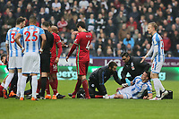 Jonathan Hogg of Huddersfield is protesting to the mathcg referee while injured on the ground during the Premier League match between Huddersfield Town and Swansea City and at the John Smith's Stadium Huddersfield, England, UK. Saturday 10 March 2018