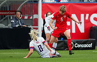 CARSON, CA - FEBRUARY 9: Julie Ertz #8 of the United States tackles Rebecca Quinn #5 of Canada during a game between Canada and USWNT at Dignity Health Sports Park on February 9, 2020 in Carson, California.