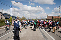 The Racing at Dwars door Vlaanderen was temporarily neutralized as the men's and women's fields came too close to each other on their journeys to Waregem. <br /> But chaos erupted as some riders stopped while others kept moving forward and a funny yet strange cat&mouse game between riders & UCI commissaires began...<br /> <br /> 74th Dwars door Vlaanderen 2019 (1.UWT)<br /> One day race from Roeselare to Waregem (BEL/183km)<br /> <br /> ©kramon
