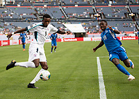 DENVER, CO - JUNE 19: Maykel Reyes #9 attacks with Samuel Camille #18 defending during a game between Martinique and Cuba at Broncos Stadium on June 19, 2019 in Denver, Colorado.
