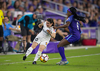 Orlando, FL - Saturday March 24, 2018: Utah Royals midfielder Diana Matheson (10) plays the ball away from Orlando Pride forward Chioma Ubagagu (6) during a regular season National Women's Soccer League (NWSL) match between the Orlando Pride and the Utah Royals FC at Orlando City Stadium. The game ended in a 1-1 draw.