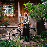 Olga Ivanovna and her bicycle. She goes everywhere by bike - to church, shopping and to visit needy neighbors, a family of ex-Moskovites. The day I met her, she was taking last year's potatoes to them.