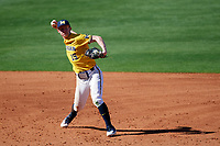 Michigan Wolverines third baseman Jimmy Kerr (15) throws to first base during a game against Army West Point on February 17, 2018 at Tradition Field in St. Lucie, Florida.  Army defeated Michigan 4-3.  (Mike Janes/Four Seam Images)