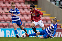 7th February 2021; Leigh Sports Village, Lancashire, England; Women's English Super League, Manchester United Women versus Reading Women; Jess Fishlock of Reading tackles Jessica Sigsworth of Manchester United Women