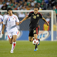 Mexico's Andres Guardado receives the ball in front of Costa Rica's Jose Salvatierra.  Mexico defeated Costa Rica 4-1 at the 2011 CONCACAF Gold Cup at Soldier Field in Chicago, IL on June 12, 2011.
