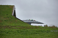 Norwegian F-16 from emerge from a shelter at Bodø air station in Norway. . The military Arctic Challenge Exercise 2015 (ACE 15) is a large crossborder exercise, with flying in Norway, Sweden and Finland. Airforce aircraft from these countries as well as NATO aircraft from Germany and Great Britain train together in a vast airspace.<br /> (photo: Fredrik Naumann/Felix Features)